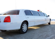White wedding limousine. White long wedding limousine decorated with flowers Stock Photos