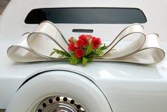 White wedding limousine. Decorative element on the white wedding limousine Stock Images