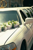 White wedding limousine decorated with flowers Stock Photography