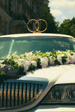 White wedding limousine decorated with flowers Royalty Free Stock Image