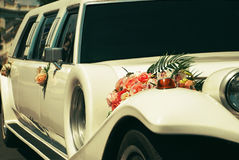 White wedding limousine decorated with flowers. Stock Photography