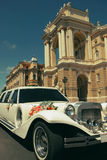 White wedding limousine decorated with flowers Royalty Free Stock Photos
