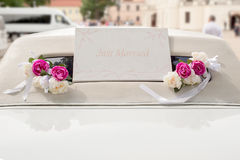 White wedding limousine decorated with flowers Stock Images