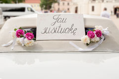 White wedding limousine decorated with flowers Royalty Free Stock Images