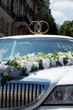 White wedding limousine decorated with rings Royalty Free Stock Photos