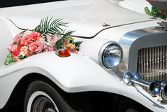 White wedding limousine with flowers Royalty Free Stock Photo