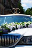 White wedding limousine with flowers Royalty Free Stock Photography