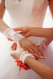 White wedding mitten on a hand of the bride Royalty Free Stock Photo