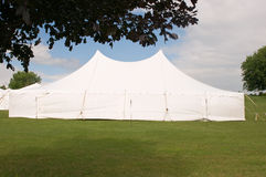 White wedding party tent. A large white wedding party tent on a grassy lawn Royalty Free Stock Photo