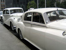 White wedding retro cars. Waiting near the church Stock Image