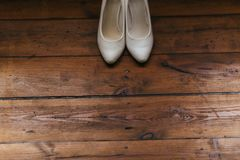 White shoes on a brown background Royalty Free Stock Photo