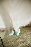 White wedding shoes on the feet of the bride Royalty Free Stock Photo