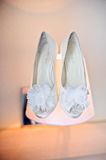 white wedding shoes on the lamp Stock Images
