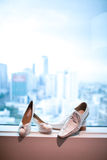 White wedding shoes. White male and female wedding shoes of the bride by a window Stock Image