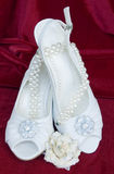 White wedding shoes with pearls necklace Stock Image