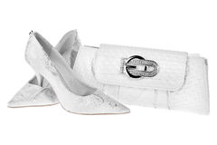 White wedding shoes and a white bag clutch Stock Images