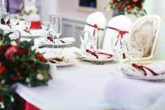 White wedding table set decorated with red ribbons Royalty Free Stock Photography