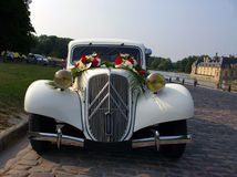 White wedding vintage car. Vintage white wedding car waiting at the castle Stock Photos