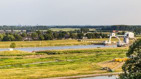 White weir in Driel Netherlands. Landscape with a view on tje big typical white weir in the river rhine near Driel in the Netherlands royalty free stock photo