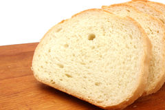 White wheat bread slices. On a cutting board Royalty Free Stock Images