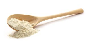 White wheat flour in wooden spoon Stock Image