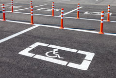 White wheelchair icon on parking lot Stock Photos