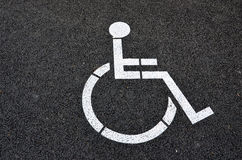White wheelchair sign on road Royalty Free Stock Images