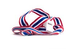 White whistles with Thailand national flag lanyard on white bac Stock Photo