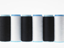 White on white, spools of thread on white background. Spools of thread colored geometric composition on a white background Royalty Free Stock Photography