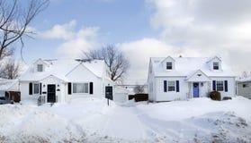 White on White. Two white suburban houses framed in white snow in Western New York Stock Image