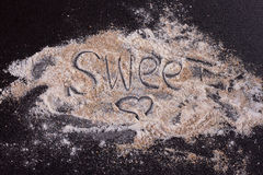 White whole-wheat flour and a spoon Royalty Free Stock Photos
