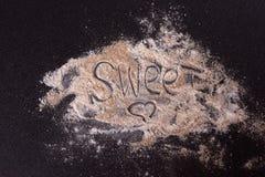 White whole-wheat flour and a spoon Stock Photo