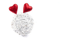 White wicker ball with two red hearts Royalty Free Stock Photo