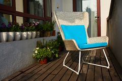 White wicker chair on the balcony royalty free stock image