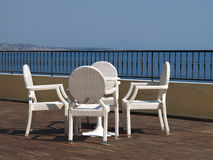 White wicker chairs on a hotel terrace Royalty Free Stock Photography