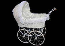 White wicker doll or baby pram  on a black background Royalty Free Stock Images