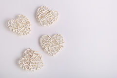 White wicker hearts on a white background Stock Photo