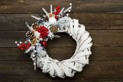 White wicker wreath. On brown wooden table Stock Photo