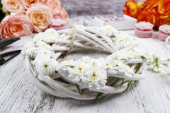 White wicker wreath decorated with tiny daisies Royalty Free Stock Images