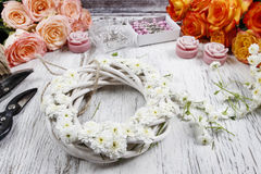 White wicker wreath decorated with tiny daisies Royalty Free Stock Image