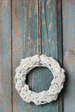 White wicker wreath of tiny chrysanthemums Stock Photography