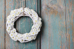 White wicker wreath of tiny chrysanthemums Stock Photos