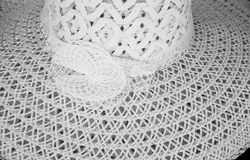 White Wide Brimmed Sun Hat with Woven Pattern. A white wide brimmed sun hat with a woven pattern. It was in a store on Wasaga Beach, Ontario, Canada Stock Photos