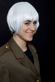 White wig. Young woman with a russian army coat and a white wig Stock Photos