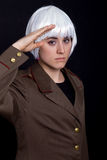 White wig. Young woman with a russian army coat and a white wig Stock Image