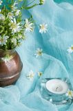 White wild flowers in a brass jug Stock Image