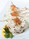 White and wild rice with fish grilled on a stick Royalty Free Stock Photos