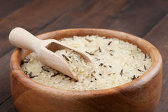 White and wild rice in wooden bowl Royalty Free Stock Image