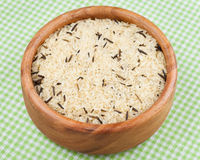 White and wild rice in wooden bowl Royalty Free Stock Images