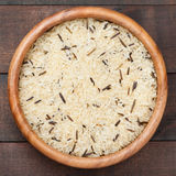 White and wild rice in wooden bowl on table Stock Photos